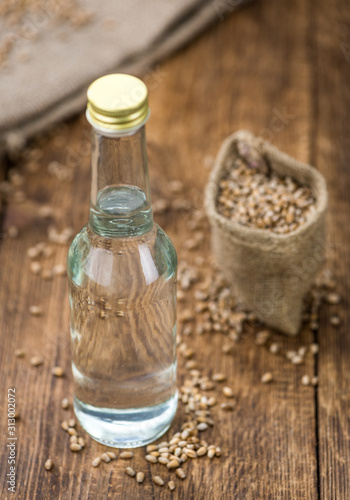 Portion of fresh Wheat Liqueur on an old wooden table