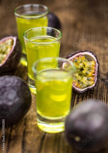 Fresh Passion Fruit Liqueur as detailed close-up shot (selective focus)