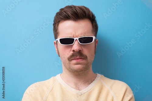 Fotografie, Obraz geek retro caucasian man with funny mustache sunglasses with serious emotion on
