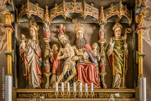 Fotografie, Obraz  Reredos from 1490 with sculptures of God the Father, Jesus and Virgin Mary