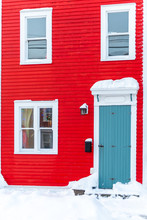 A Red Two Storey House With Wh...