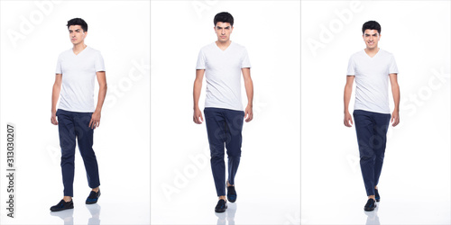 Obraz Young Caucasian Man in Empty area blank white T-Shirt Jeans stand and walk in turning head look with feeling happy smile strong, white background isolated, full length collage group concept - fototapety do salonu