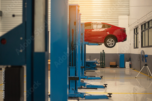 Red Car Repair Station Car Raised On Car Lift In Autoservice Interior Car Care Center The Electric Lift For Cars In The Service Buy This Stock Photo And Explore Similar Images At Adobe Stock