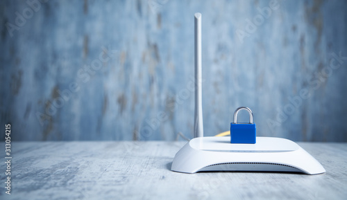 Fotografía Internet router with padlock. Network and data protection