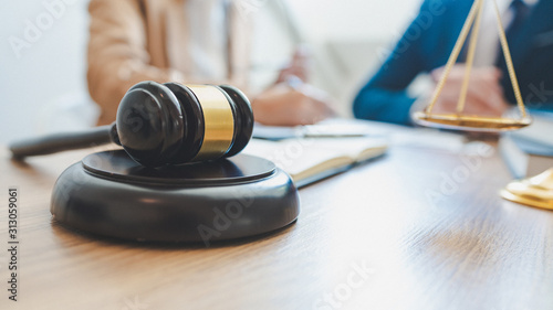 Fototapeta lawyer lawsuit notary consultation or discussing negotiation legal case with document contract women entrepreneurs in the office obraz