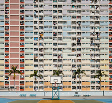 Basketball Court And Rainbow Colored Building Facade In HongKong -