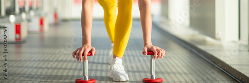 Physically fit woman at the gym with dumbbells ready to strengthen her arms and Tapéta, Fotótapéta