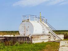 Reservoir For Sludge Of Oil Emulsion. Equipment At The Oil Field.