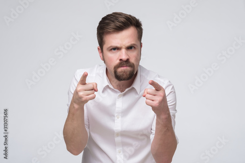 angry young man with beard accusing you, pointing finger at you Canvas Print