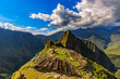 Peru, Eastern Cordillera, Cusco region. Historic Sanctuary of Machu Picchu seen from House of Guards. There is Huayna Picchu raised above the Inca city