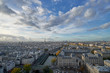 Aerial panorama of the Paris cityscape with Eiffel Tower, river Seine and a beautiful cloudy sky over France.