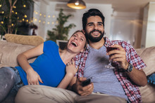 Happy Young Couple Relaxing An...