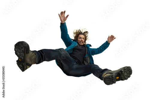 Obraz A second before falling. Caucasian young man falling down in moment with bright emotions and facial expression. Male model in casual clothes on white. Shocked, scared, screaming. Copyspace for ad. - fototapety do salonu
