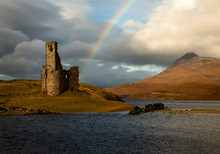 Ardvreck Castle On Loch Assynt In Scotland With A Beautiful Rainbow