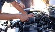 Car mechanic has checked the condition of the engine in wrench, Car repair service concept.