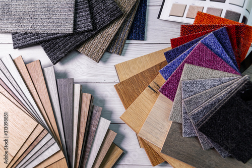 Fototapeta flooring and furniture materials - colorful floor carpet and wooden laminate samples obraz na płótnie