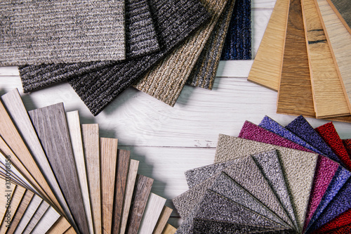 Fototapeta flooring and furniture materials - floor carpet and wooden laminate samples