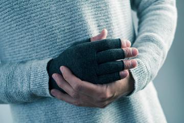man wearing a compression glove