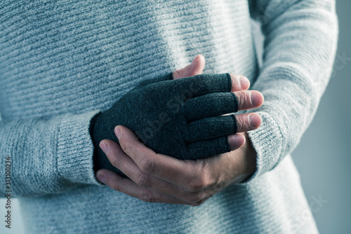 man wearing a compression glove - 313100236
