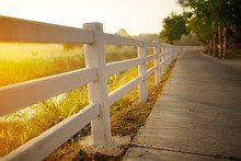 White Concrete Fence With Path...