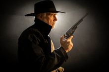 Old West Gun Fighter Looking At Someone And Ready For A Fight