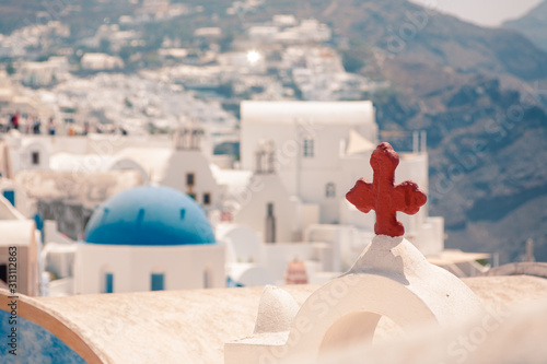 Fototapeta Classical view on the decoration and architecture of Oia village Santorini at sun weather obraz
