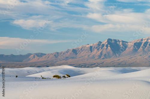Dunes in front of mountain range at White Sands National Park in New Mexico