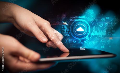 Obraz na plátne  Hand holding tablet with cloud storage technology concept