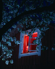 Mysterious Red Light In Cabin Window At Night