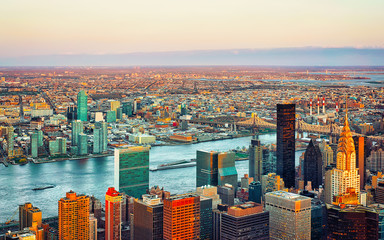 Fototapeta Nowy York Panoramic view on Midtown district of Manhattan in New York, NYC. East river and Queensboro Bridge in Long Island City. Skyline, USA. American architecture building. Aerial Panorama of Metropolis.