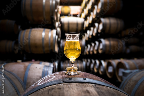 Photo Beer Barrels with glass of Craft Beer