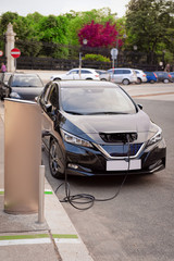 Electric Car Charging station at Vienna in Austria. Battery hybrid vehicle eco charger. Future energy power. Green technology. Transport and plug. Fuel recharge. Clean ecology concept. Modern supply