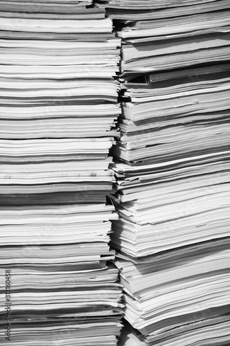 A Tall Pile Of Papers, Documents & Magazines