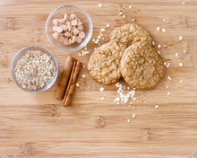 Oatmeal Butterscotch Cookies Fresh From The Oven; Oatmeal Scotties Cookies On A Wooden Cutting Board