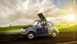 canvas print picture - Frau fährt in Ihrem Elektroauto übers land und lädt diese mittels Solarpanels