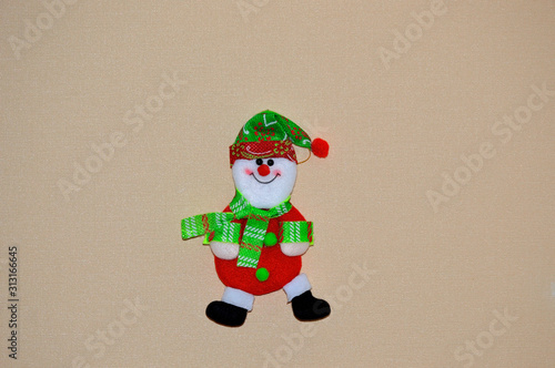 Photo Christmas decoration at home or ate in the form of a toy a cheerful snowman