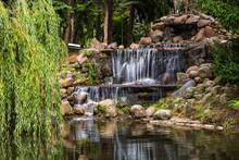 Poland, Warsaw, Small Waterfall In Skaryszewski Park