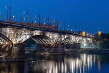 Poland, Warsaw, Illuminated Poniatowski Bridge At Night