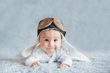 Cute Smiling Baby In Cap Of Pi...