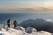 Mountaineers Hiking On Snowy M...