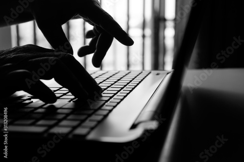 Fotografia hacker or cyber crime hand reaching, stealing information on laptop, attack sign