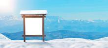 Ski Resort Sign, Billboard Mockup On A Snowy Mountain. Mountain Peaks In The Background. Copy Space Beside.
