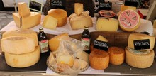 Different Types Of Cheese On A Market Counter In The Corsican City Of Ajaccio In September 2019