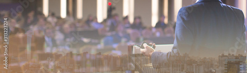 Photo Seminar presenter at corporate conference giving speech