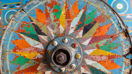 Fototapeta Painted wooden wheel from a traditional Costa Rican  ox cart
