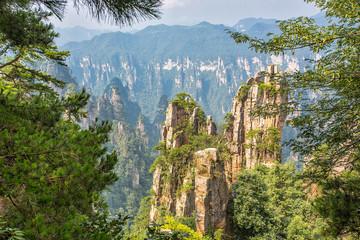 Fototapeta Góry Amazing view of natural quartz sandstone pillar the Avatar Hallelujah Mountain among green woods and rocks in the Tianzi Mountains, the Zhangjiajie National Forest Park, Hunan Province, China.