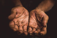 Hands Poor Man Or Beggar Begging You For Help Sitting At Dirty Slum. Concept For Poverty Or Hunger People,human Rights,donate And Charity For Underprivileged People In Third World