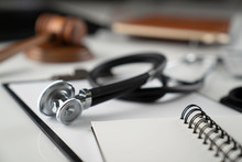 Medical Law Concept. Gavel, Notebook And Stethoscope On The White Table. Place For Text.