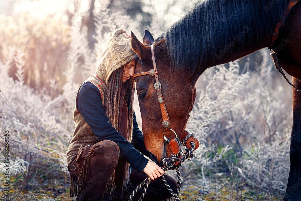 Fototapeta Portrait woman and horse outdoors. Woman hugging a horse.