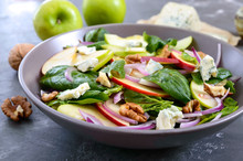 Tasty Diet Fitness Salad With Spinach, Apples, Red Onions, Blue Cheese, Nuts. Proper Nutrition. Light Concrete Background